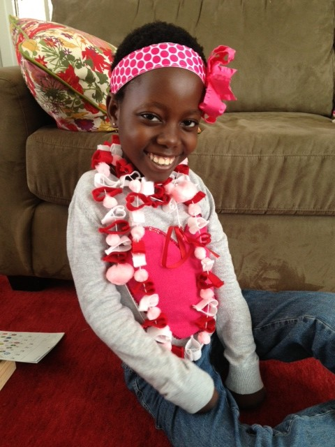 They sewed these little hearts and then strung them together to make the garland Rebeka is wearing around her neck.