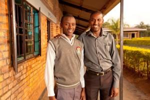 John Bosco on left, with John Africa, headmaster for New Life Christian Academy in Kayonza, Rwanda.
