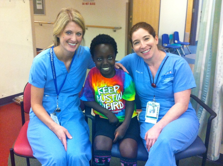 These are her physical therapists. They know just how hard to push Rebeka, and they make hard work seem fun.
