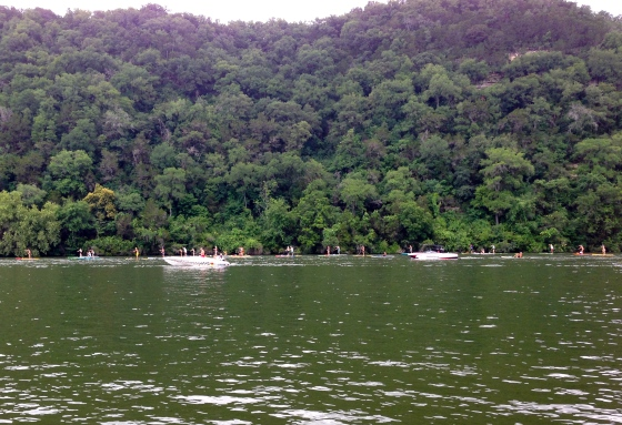 Look close . . . that's a parade of paddle boarders on Lake Austin.
